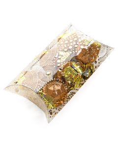 Packaged contents in gold embossed pillow box