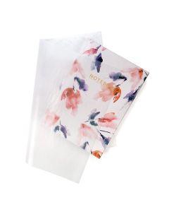 Glassine sheet over notebook