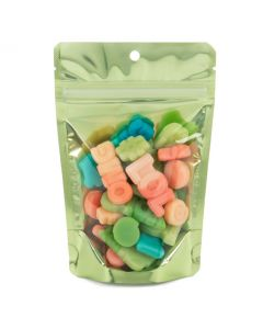 Packaged candy inside green stand up pouch w/ hang hole