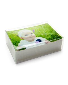 Clear box with stack of photos